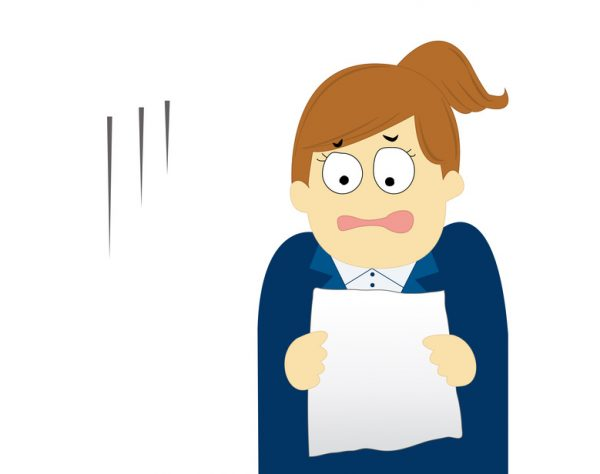 A disappointed young woman looking at a document