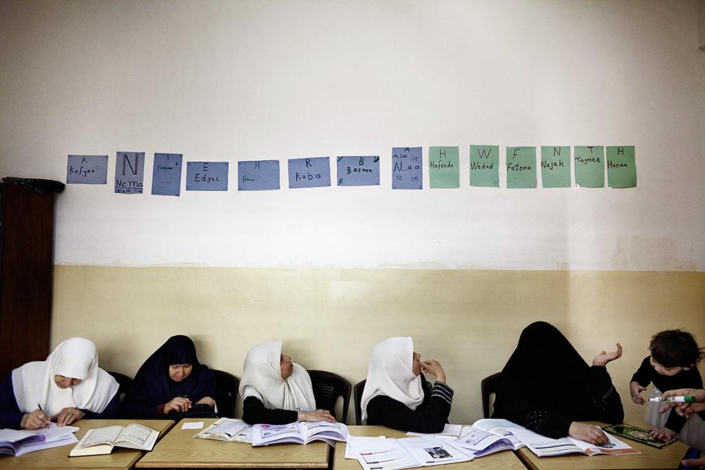 Jordanian women attend a literacy class in the suburbs of Amman 30 May 2012.